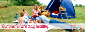 family camping in tents in summer